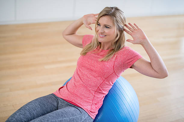 Woman Exercising At Home Weight Loss Stock Photo - Download