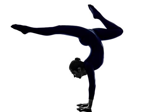 woman exercising eka pada viparita dandasana pose yoga