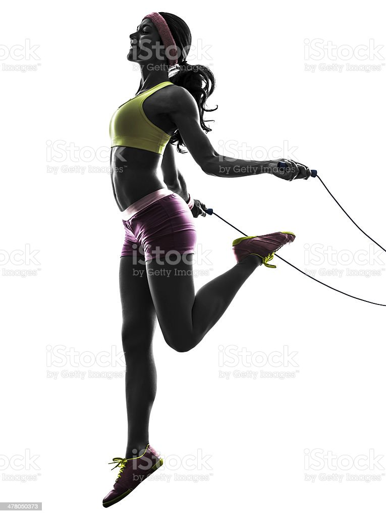 woman exercising fitness jumping rope  silhouette stock photo