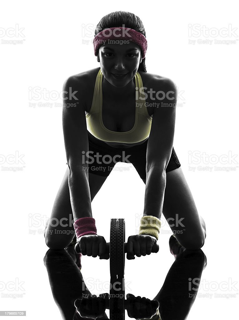 woman exercising fitness workout abdominal toning wheel silhouette stock photo