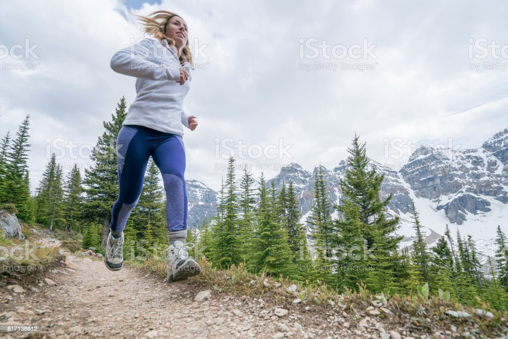 Woman exercising for cross-country running stock photo