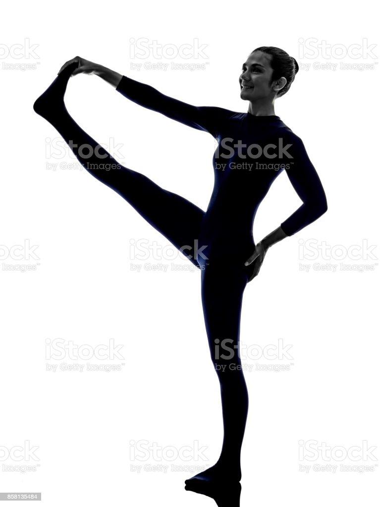 woman exercising Hasta Padangusthasana hand to big toe pose yoga stock photo