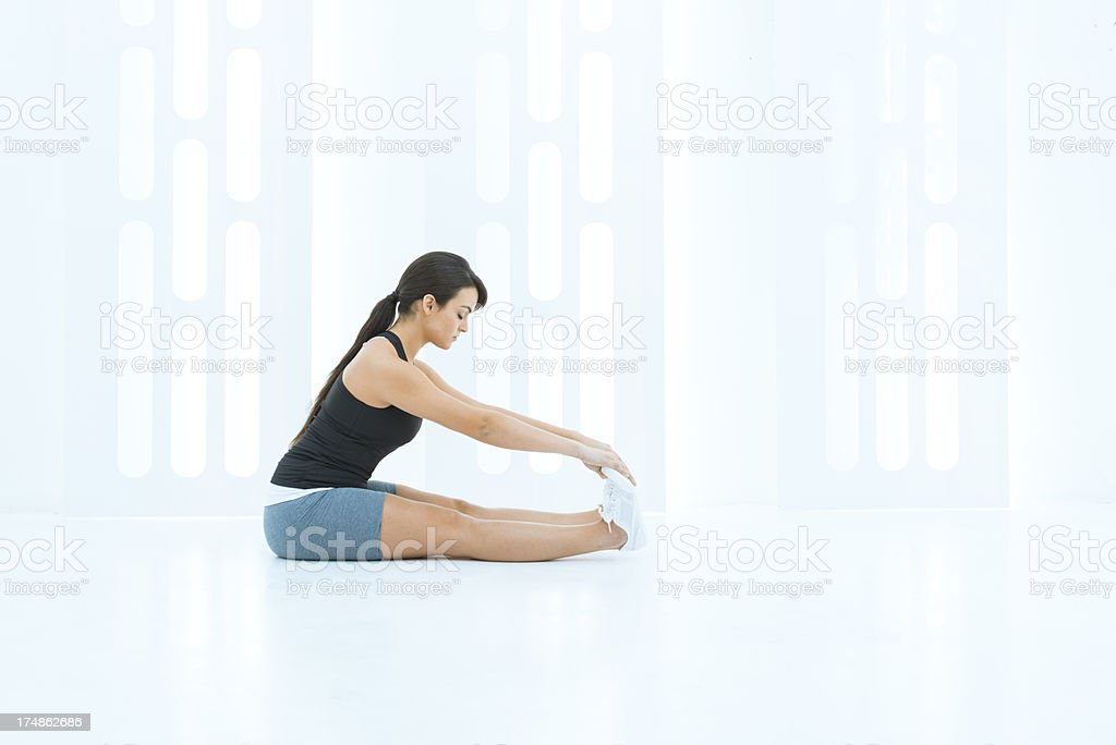 Woman exercising in a design gym royalty-free stock photo