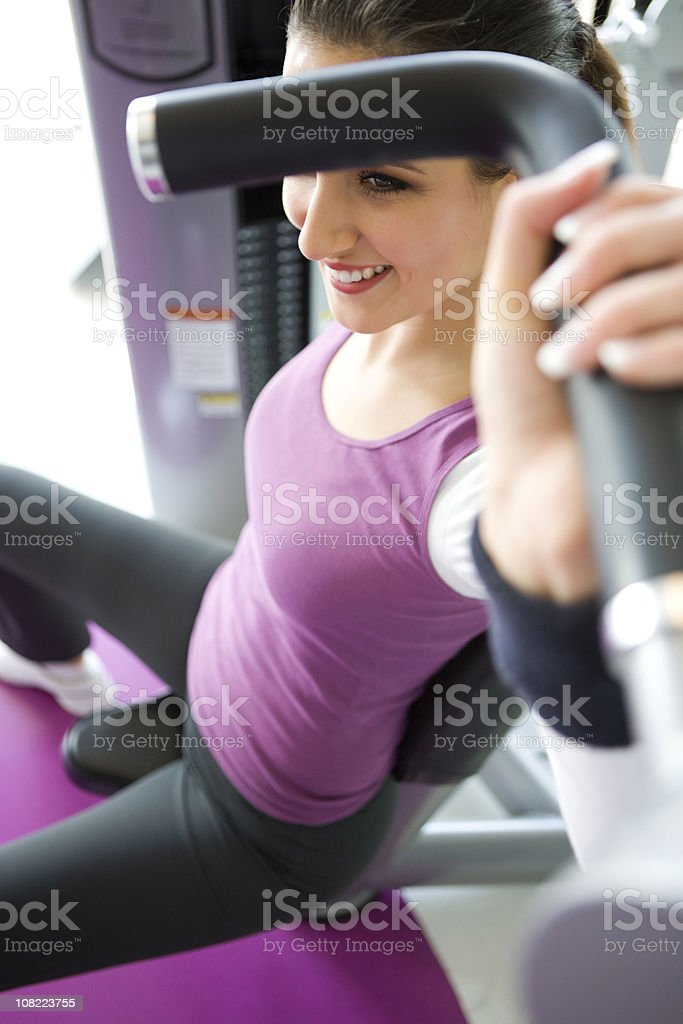 Woman exercising in a gym royalty-free stock photo