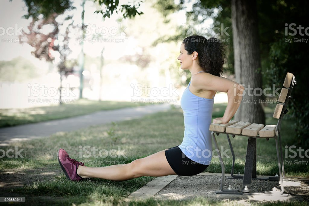 Woman Exercising in City Park stock photo