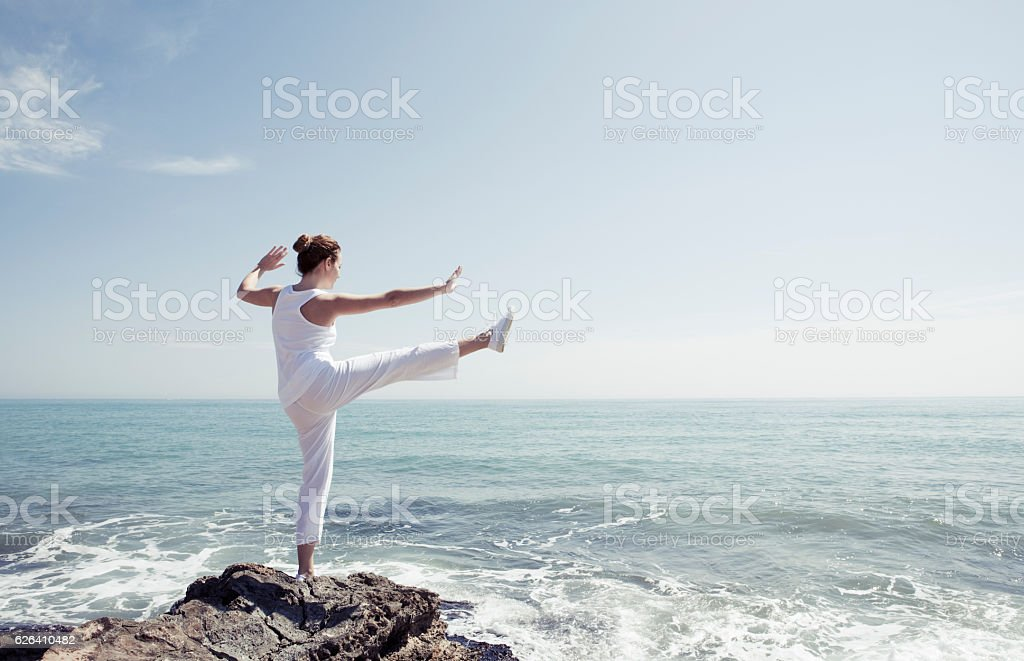 Woman exercising in front of the sea stock photo