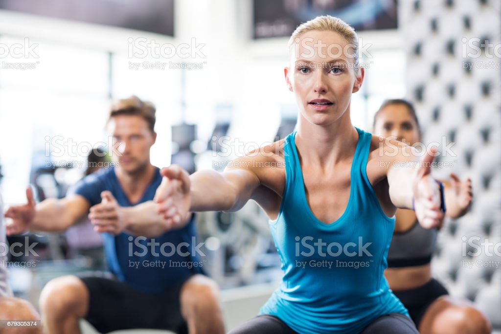 Woman exercising in gym royalty-free stock photo