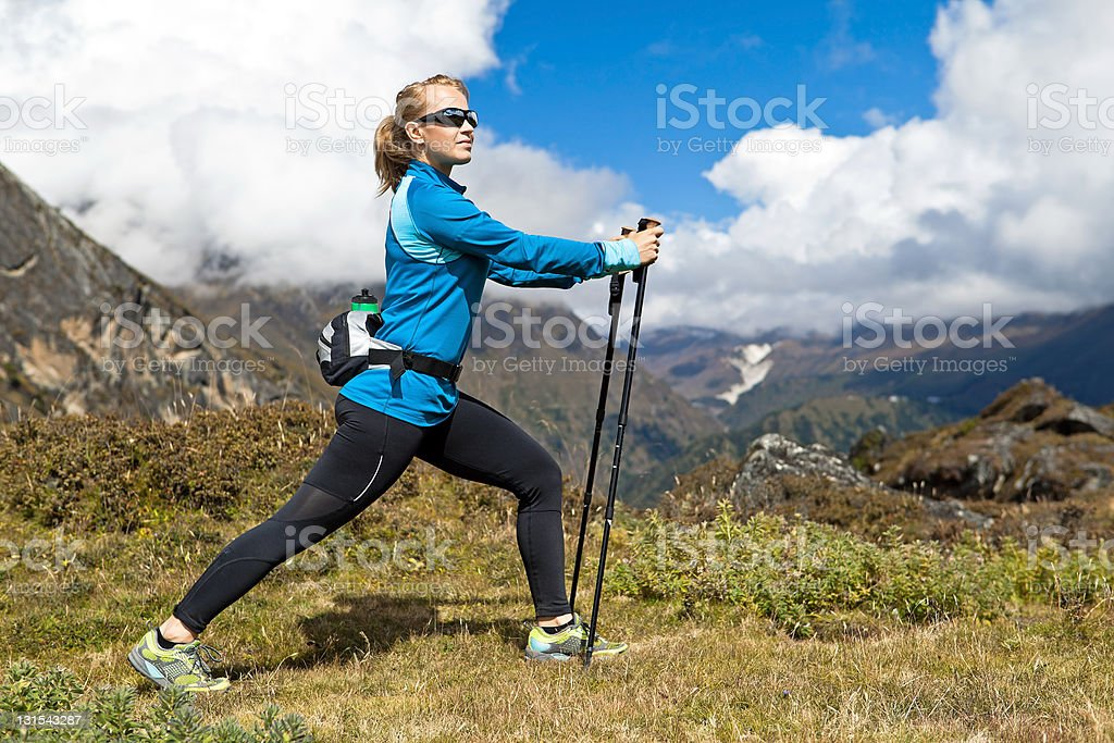 Woman exercising in mountains stock photo