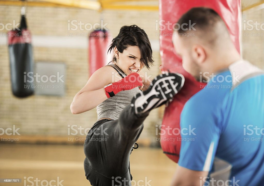 Woman exercising kickboxing. stock photo