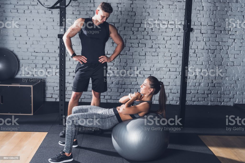 woman exercising on fitness ball royalty-free stock photo