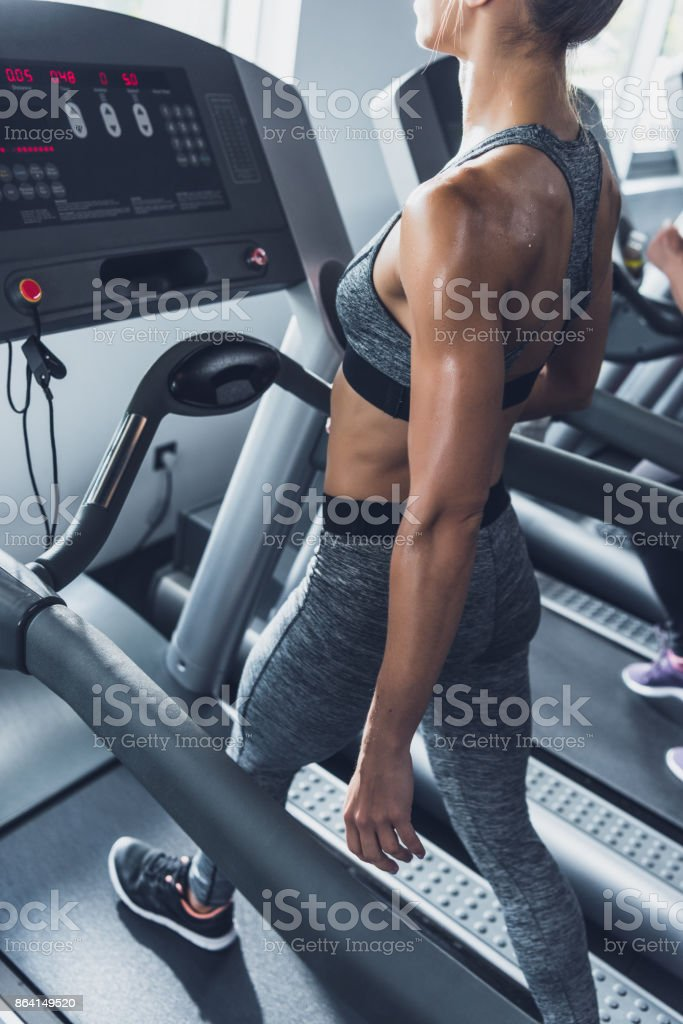 woman exercising on treadmill royalty-free stock photo