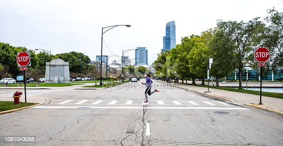 Woman exercising outdoors in the city, Chicago, USA.