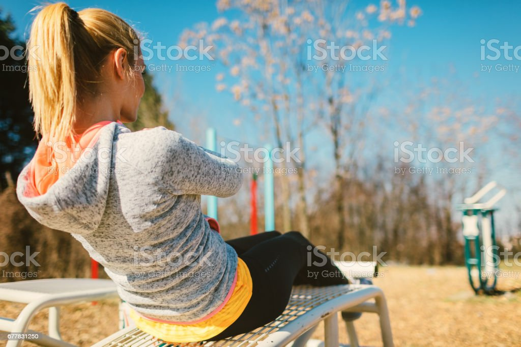 Woman exercising outdoors royalty-free stock photo