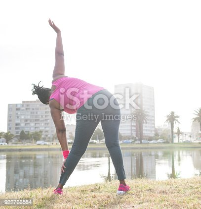 851958232 istock photo Woman exercising outdoors 922766584