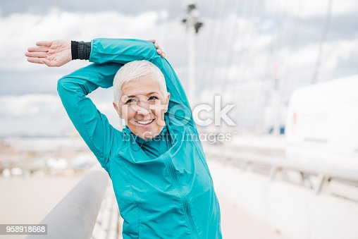 istock Woman exercising outdoors 958918668