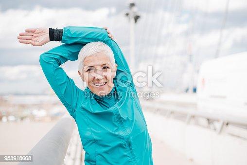 1057638814 istock photo Woman exercising outdoors 958918668