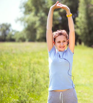479652946 istock photo woman exercising outdoors with headphones 479640958