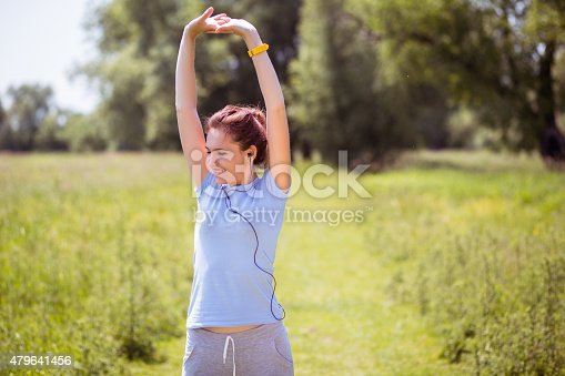 479652946istockphoto woman exercising outdoors with headphones 479641456