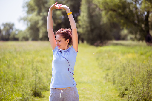 479652946 istock photo woman exercising outdoors with headphones 479641456