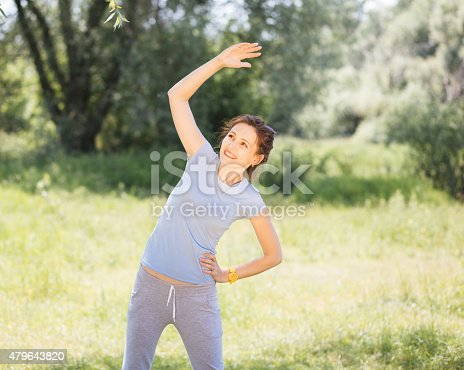 479652946istockphoto woman exercising outdoors with headphones 479643820
