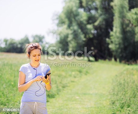 479652946istockphoto woman exercising outdoors with headphones 479643824