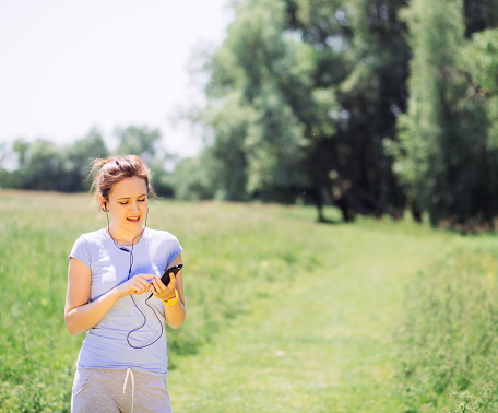 479652946 istock photo woman exercising outdoors with headphones 479643824