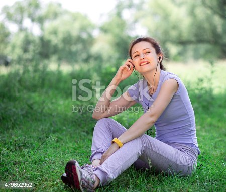 479652946istockphoto woman exercising outdoors with headphones 479652952