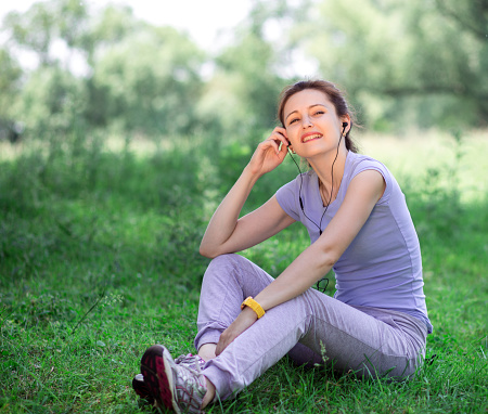 479652946 istock photo woman exercising outdoors with headphones 479652952