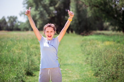 479652946 istock photo woman exercising outdoors with headphones 479733224
