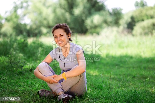 479652946istockphoto woman exercising outdoors with headphones 479733240