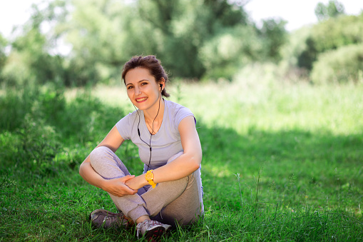 479652946 istock photo woman exercising outdoors with headphones 479733240