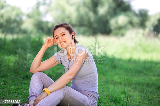 479652946istockphoto woman exercising outdoors with headphones 479733252