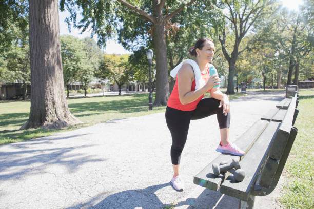 Woman exercising outside in the park
