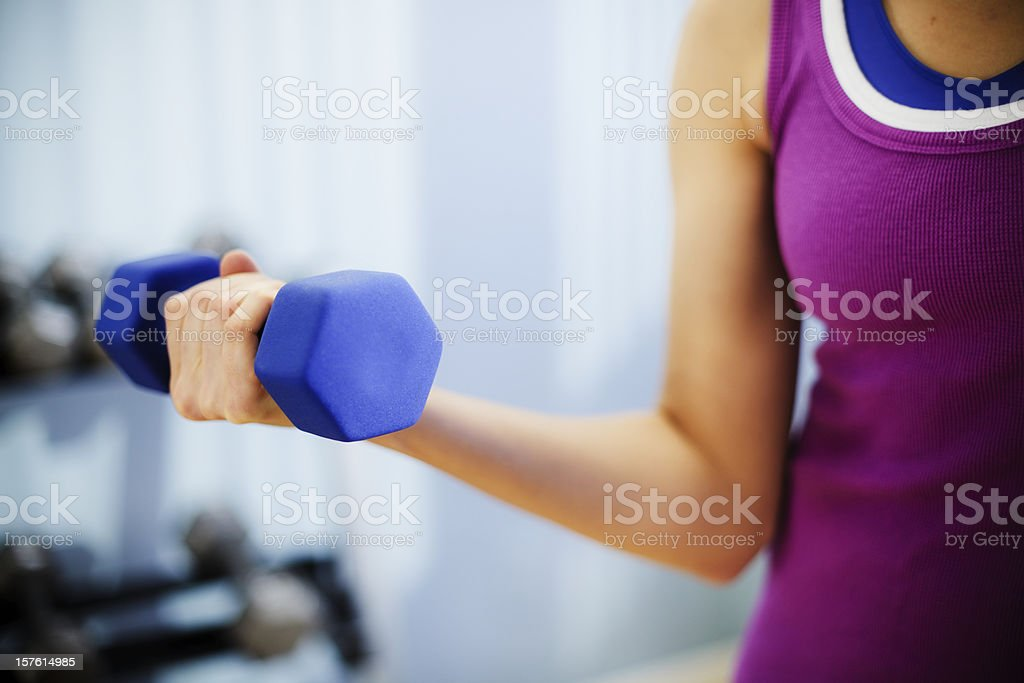 Woman Exercising With a Dumbbell stock photo