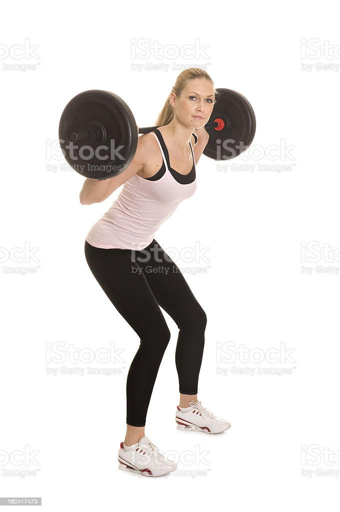 Woman exercising with Barbell royalty-free stock photo