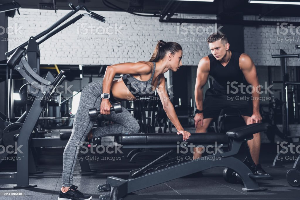woman exercising with dumbbell in gym royalty-free stock photo