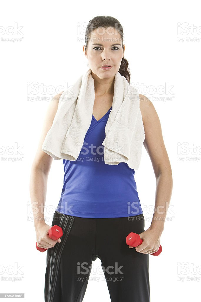 Woman exercising with dumbbells royalty-free stock photo
