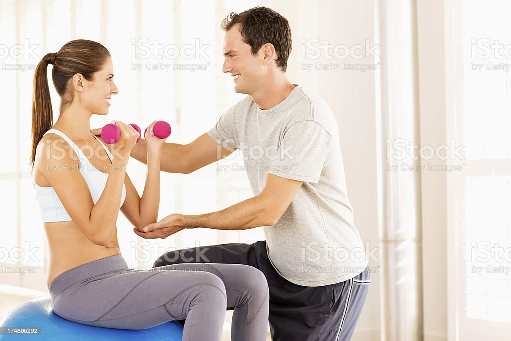 Woman Exercising With Fitness Trainer royalty-free stock photo