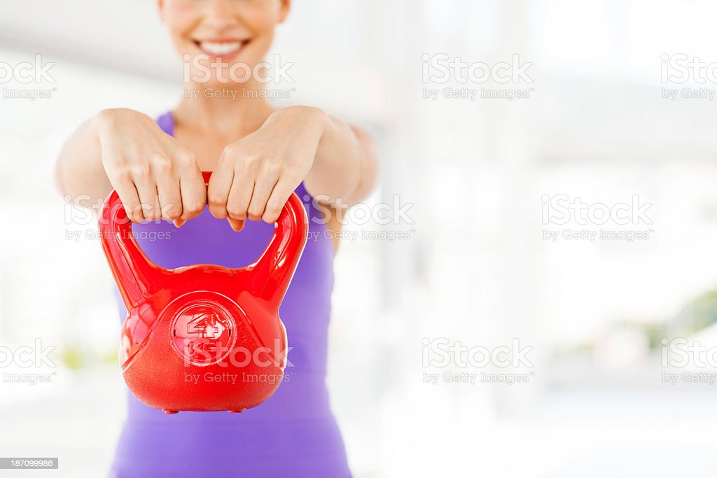 Woman Exercising With Kettle Bell In Gym royalty-free stock photo