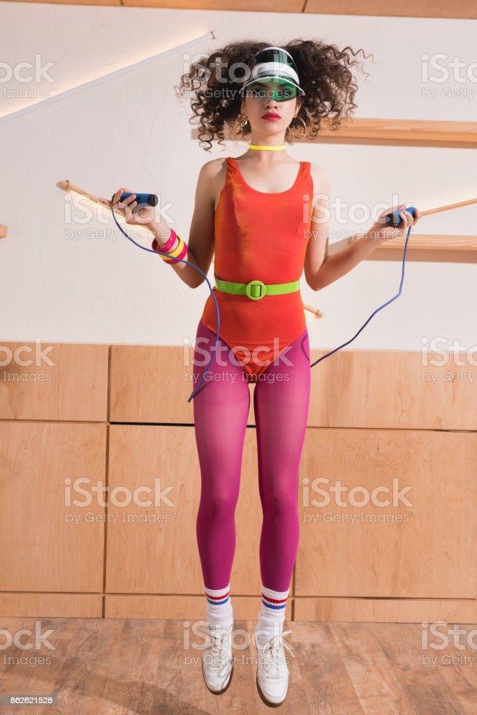 woman exercising with skipping rope stock photo