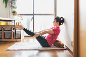 istock Woman exercising Yoga at home 1270379802