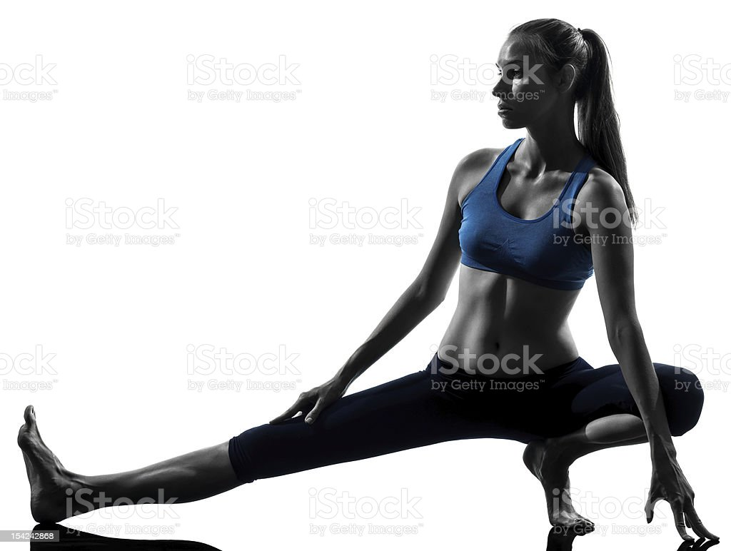 woman exercising yoga stretching legs warm up royalty-free stock photo