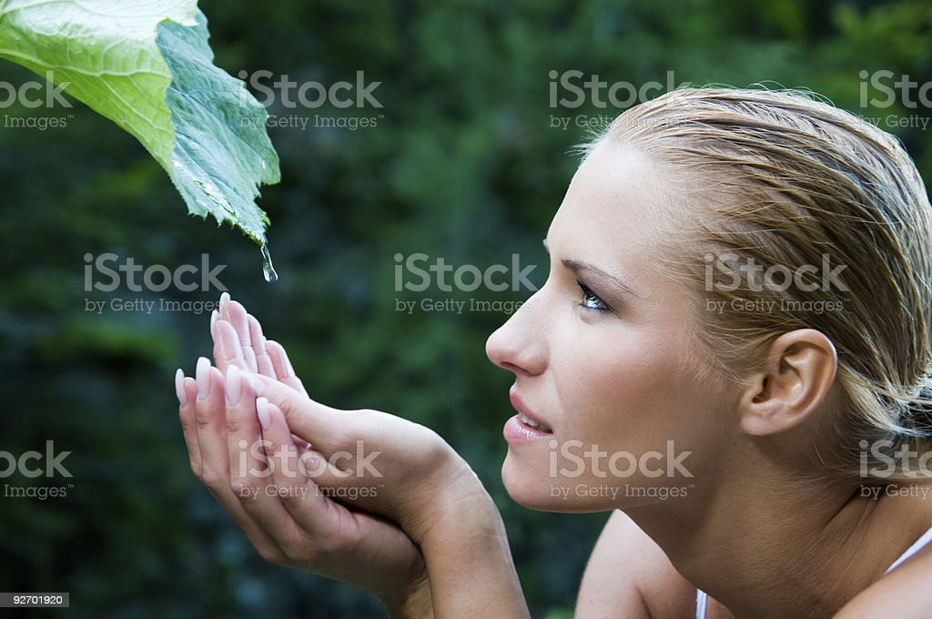 A woman experiencing the purity of nature royalty-free stock photo