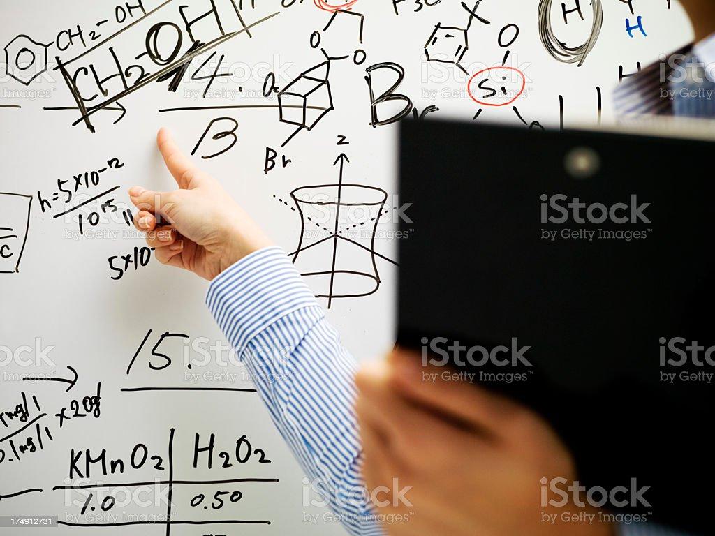 Woman explaining a formula royalty-free stock photo