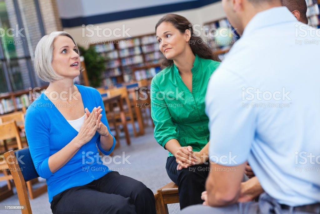 Woman explaining something to her friendly support group royalty-free stock photo