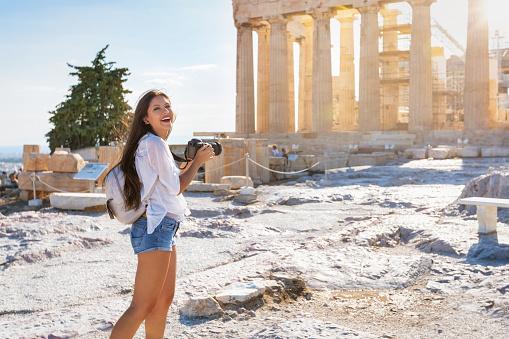 Woman explores the Parthenon Temple at the Acropolis of Athens, Greece