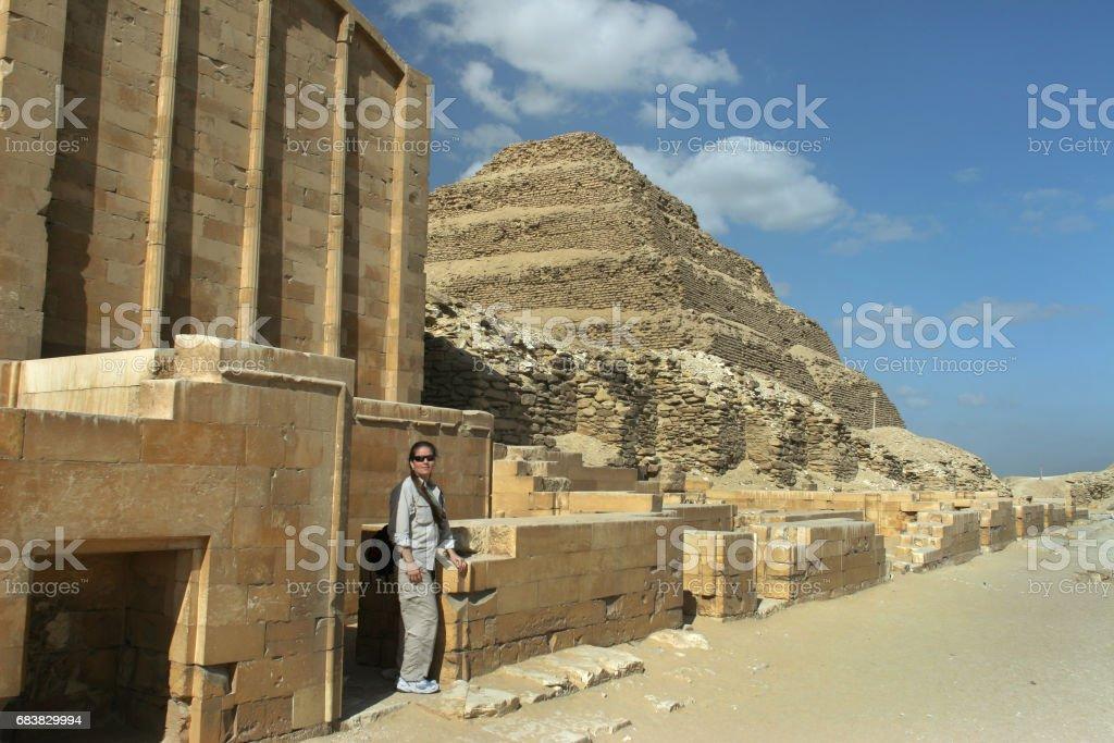 Woman explores Userkaf mortuary temple Djoser Step Pyramid Saqqara Egypt stock photo