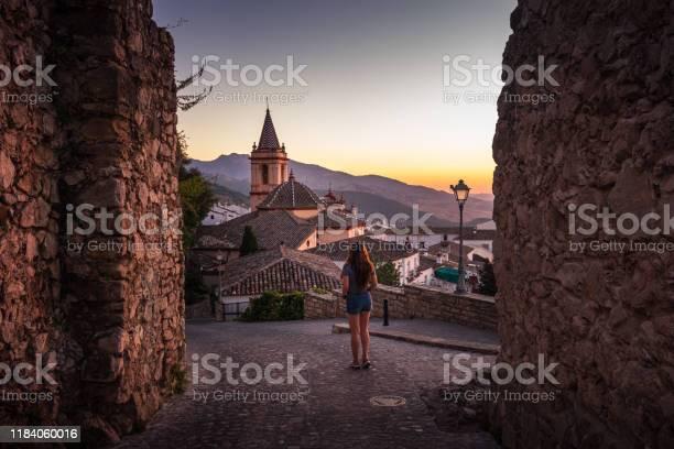Woman exploring cobblestone streets of zahara de la sierra in spain picture id1184060016?b=1&k=6&m=1184060016&s=612x612&h=yzzrx2tma3 zycwstnpbtaqdpie menchinpypptxiy=
