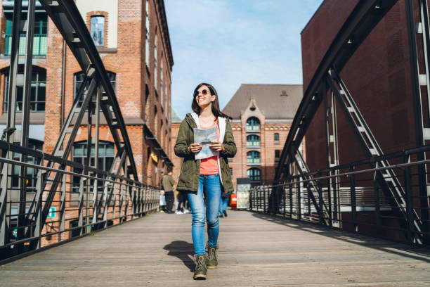 Woman exploring Hamburg with a map stock photo