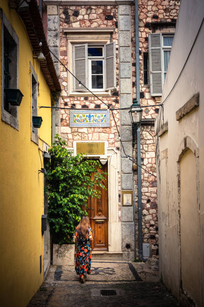 Woman exploring the alleys of the Alfama District in Lisbon, Portugal stock photo